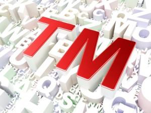 Law concept: Trademark on alphabet background